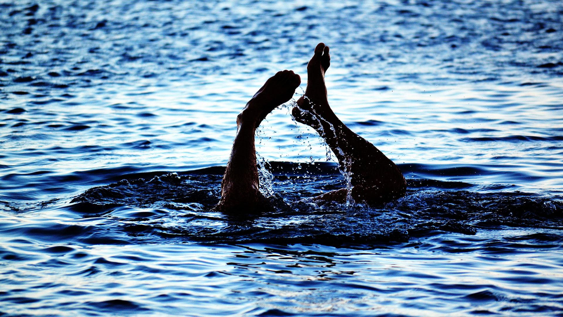 Adult Showing Feet at Lake